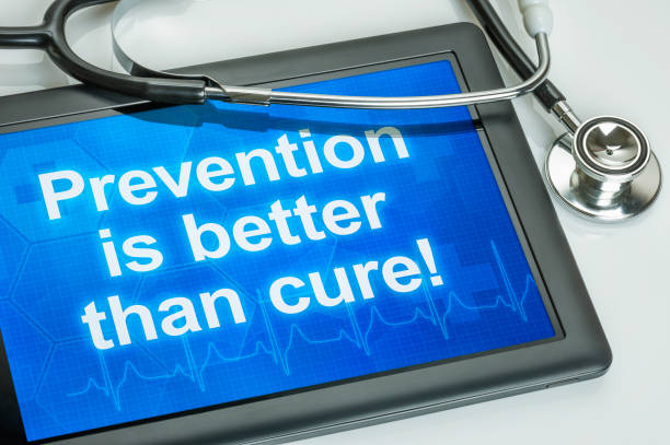 tablet with the text prevention is better than cure - screening stock photos and pictures