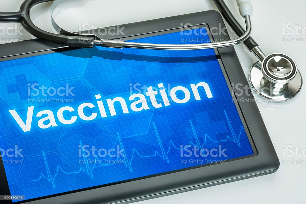 Tablet with the text Vaccination on the display stock photo