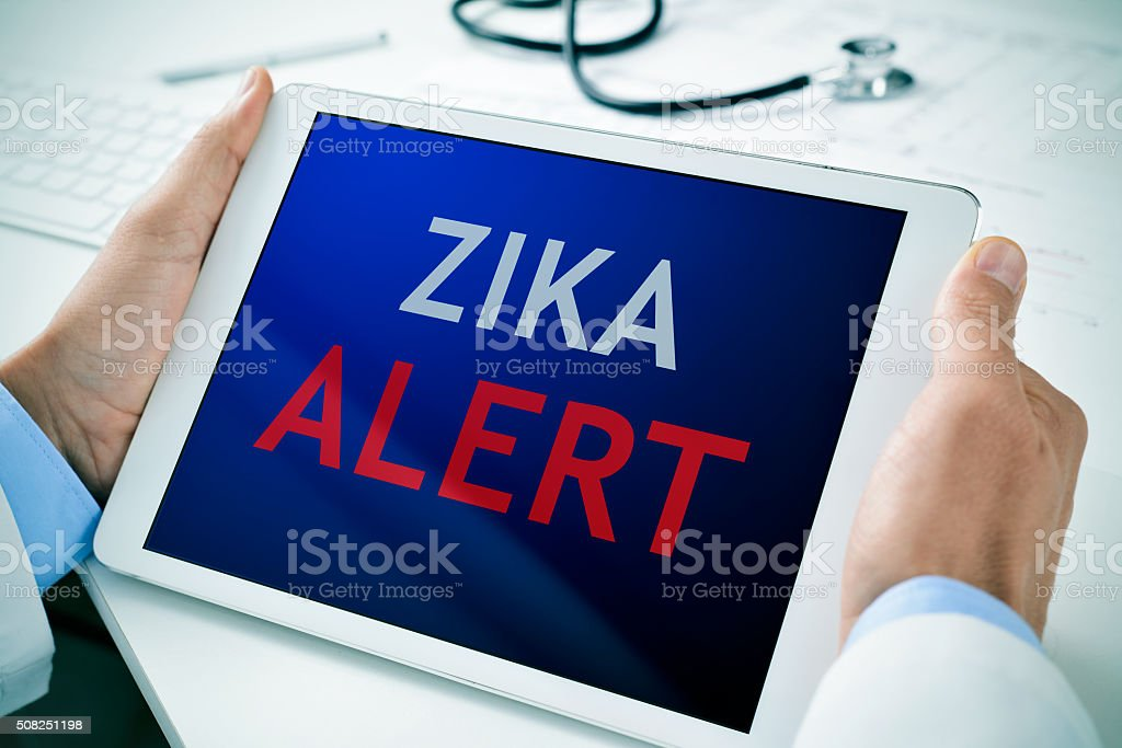 tablet with the text zika alert stock photo