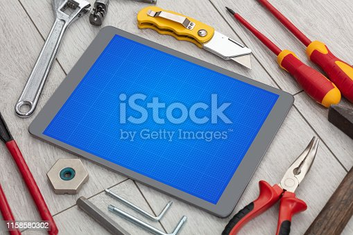 istock Tablet with tools and grid screen concept 1158580302