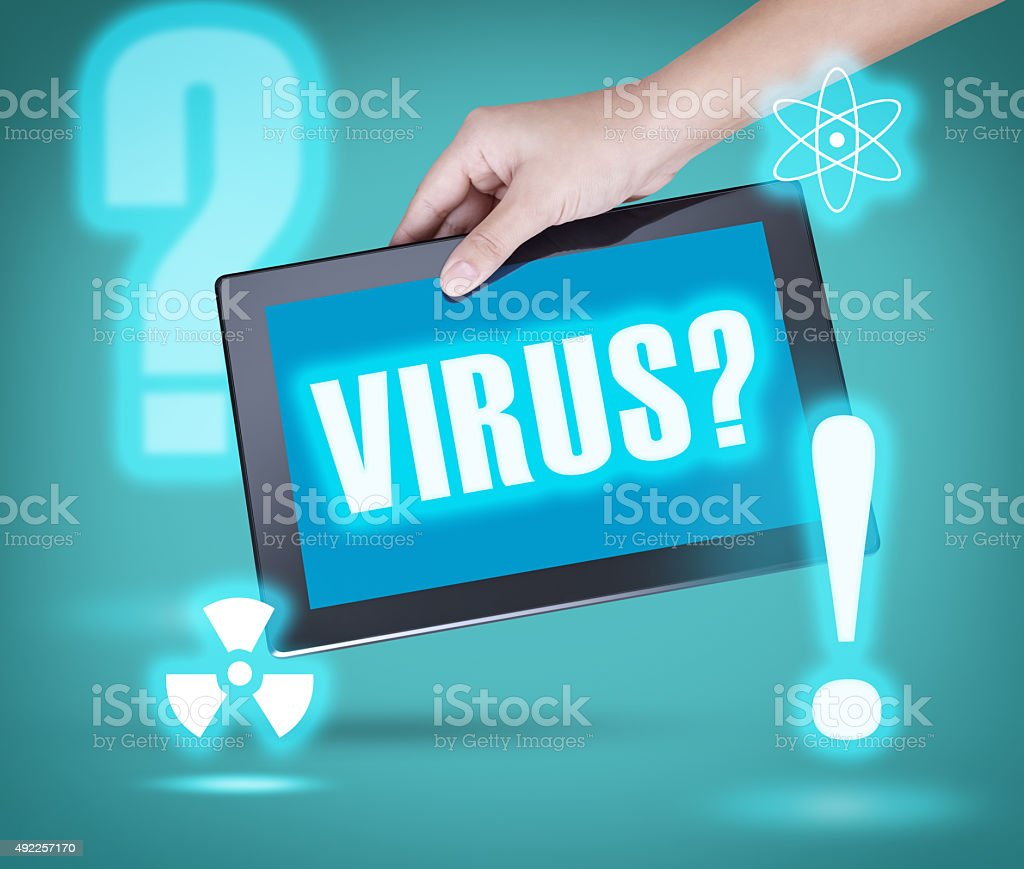 Tablet with Virus Warning stock photo