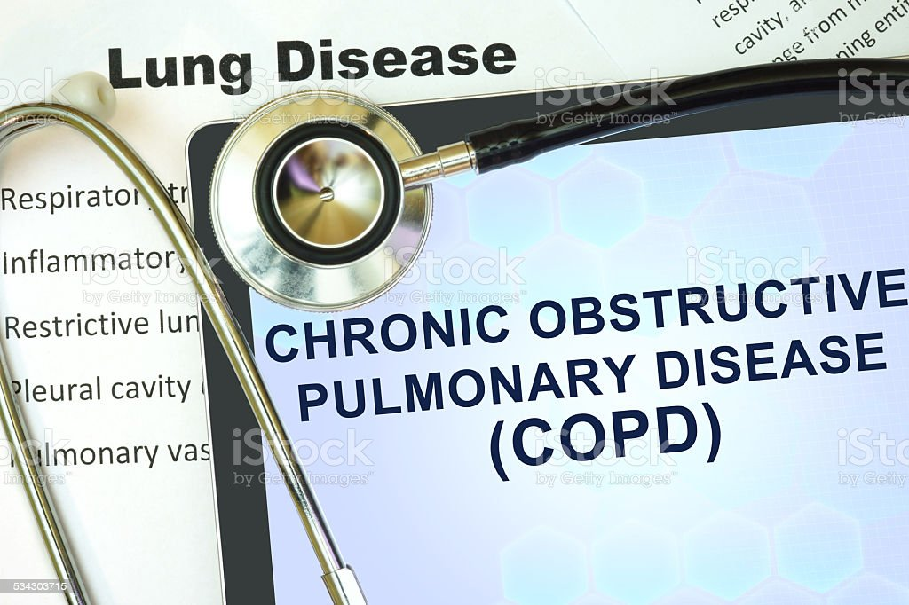 Tablet with word Chronic obstructive pulmonary disease (COPD) and stethoscope. stock photo