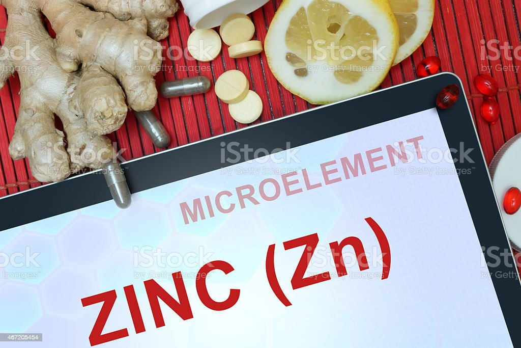 Tablet with words Zinc (Zn). microelements. stock photo