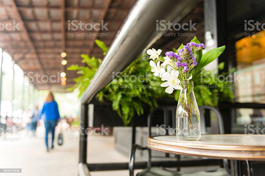 Tabletop Flowers by Sidewalk in Old Market Omaha Nebraska Restaurant stock photo