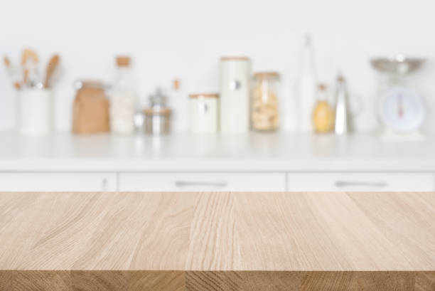 Tabletop over blurred kitchen with copy space for your composition Tabletop over blurred kitchen with copy space for your composition domestic kitchen stock pictures, royalty-free photos & images