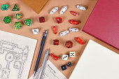 Tabletop role playing flat lay with RPG game dices, hand drawn character sheet, dungeon map