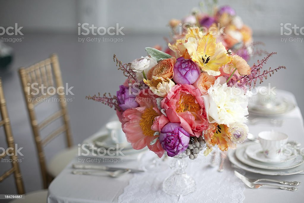 Tabletop with floral centerpieces stock photo
