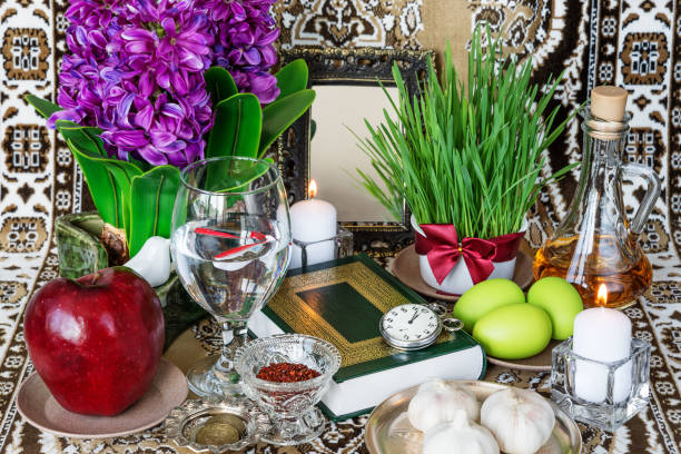 Tabletop with Haft-seen elements for Nowruz stock photo