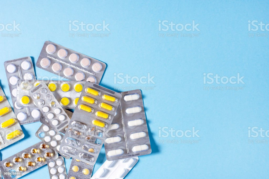 Tablets and capsules with medicines packs zbiór zdjęć royalty-free