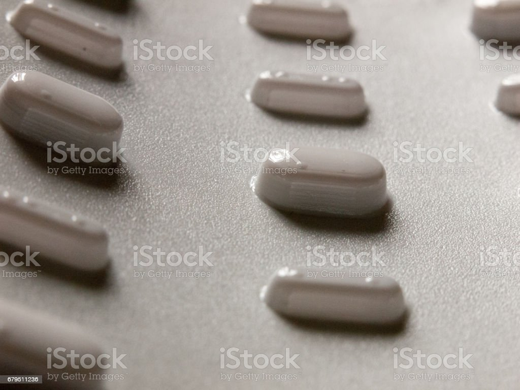 tablets in a packet upside down seen from bottom for illness relief royalty-free stock photo