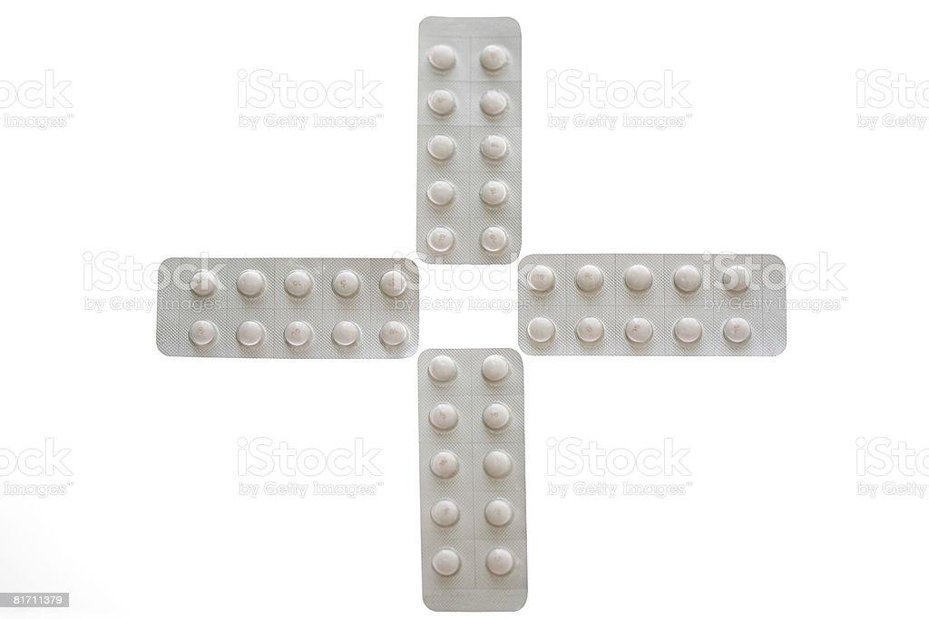 Los comprimidos en forma de cruz - foto de stock