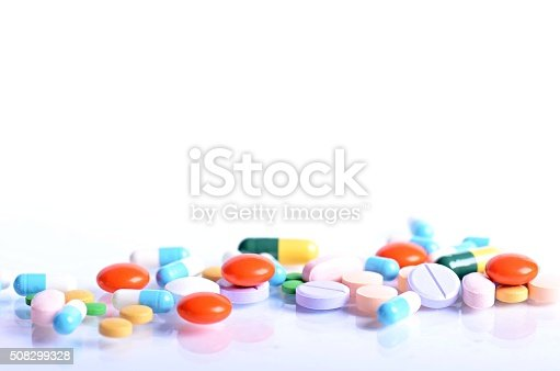 istock Tablets isolated on a white background. Reflection of pills 508299328