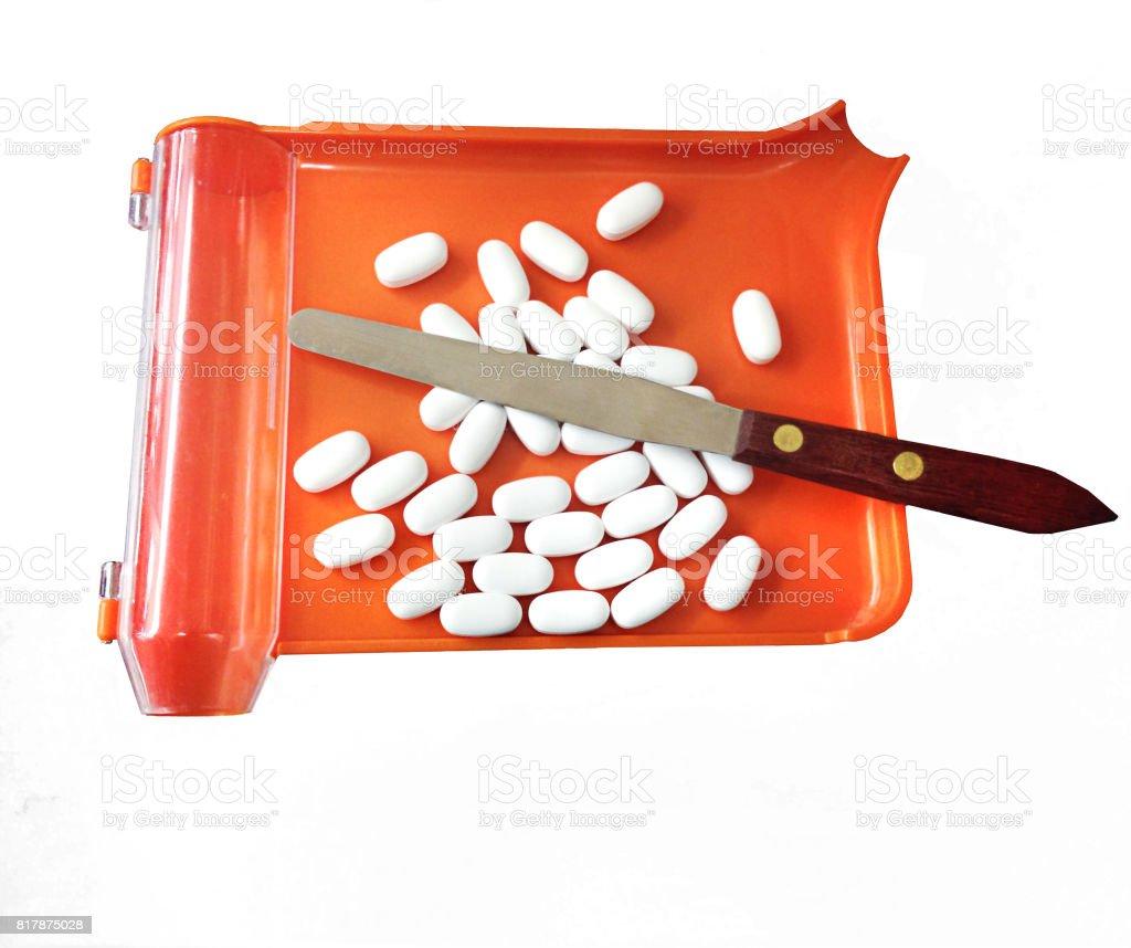 tablets on orange pharmacy tray stock photo