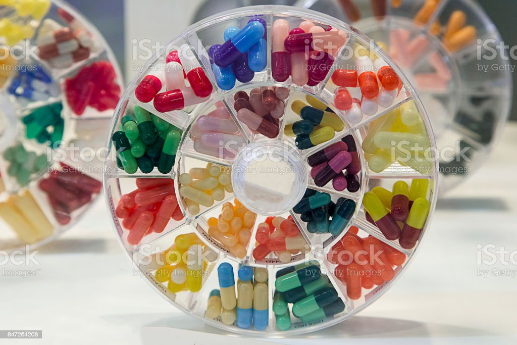 Tablets vitamins in a plastic container. stock photo
