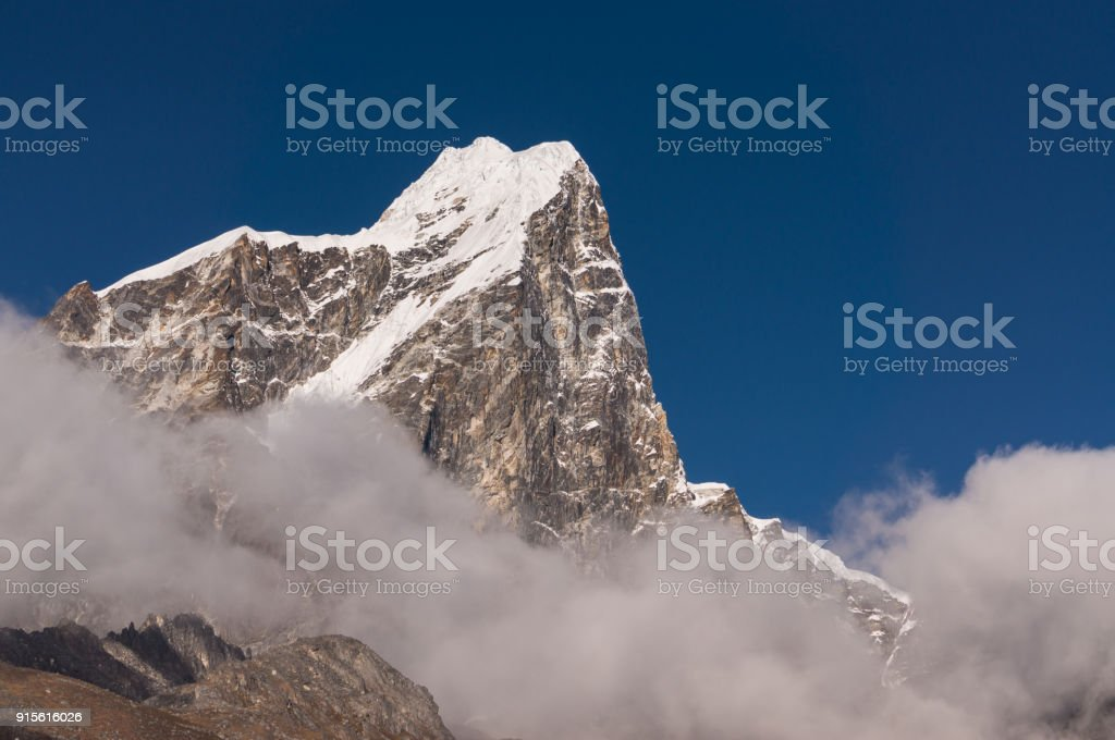 Taboche mountain peak above the cloud at Dingboche village, Everest region, Nepal stock photo