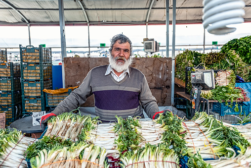 23052019 Tabriz East Azerbaijan Province Iran A Friendly Old And Gray Man Selling Fresh Celery On The Bazaar Stock Photo - Download Image Now