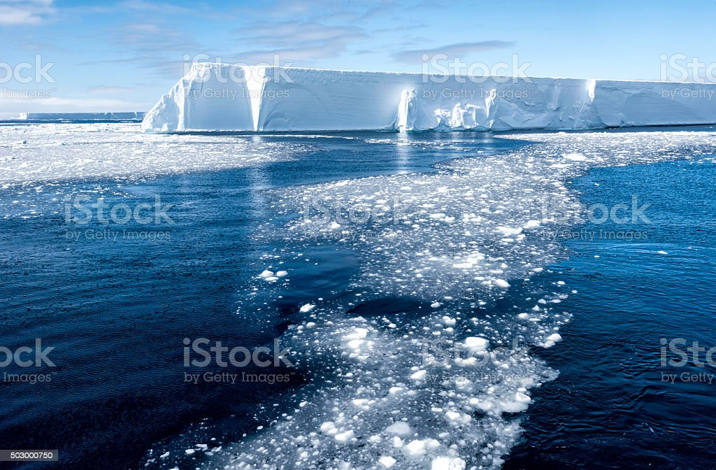 Tabular Iceberg and Brash Ice, Antarctica stock photo
