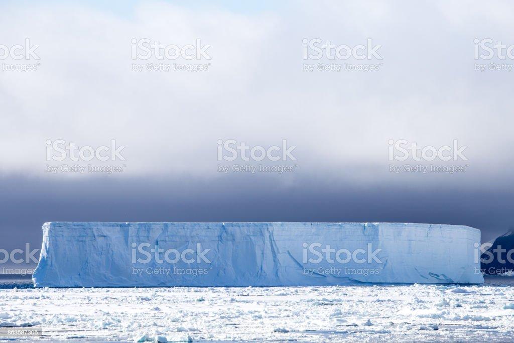 A tabular iceberg in Antarctica stock photo