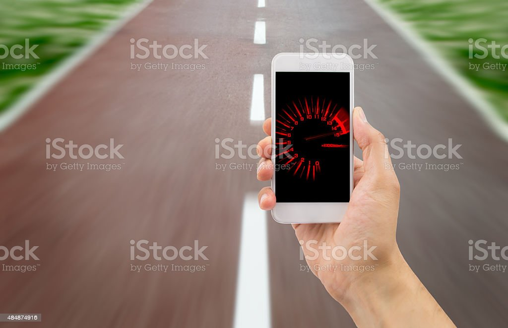 tachometer in the smartphone stock photo