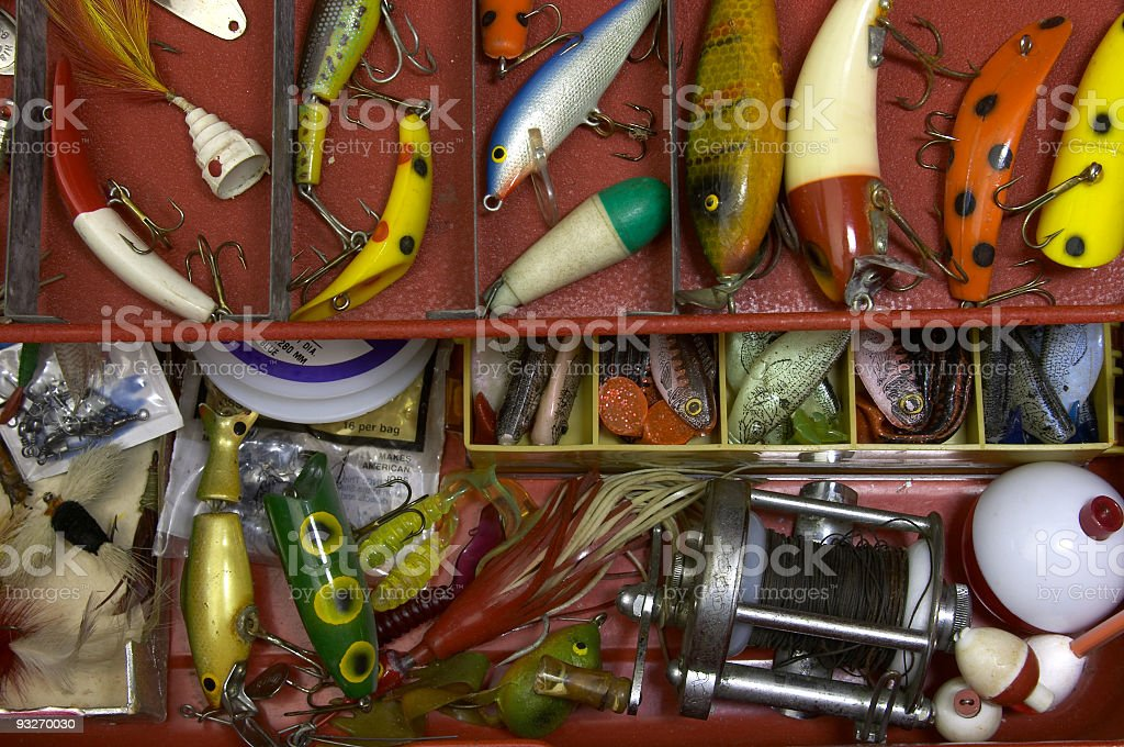 Tackle box filled with lures and hooks stock photo