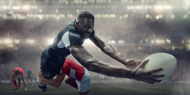 jugador de rugby abordados en el aire a punto de anotar el try - rugby fotografías e imágenes de stock
