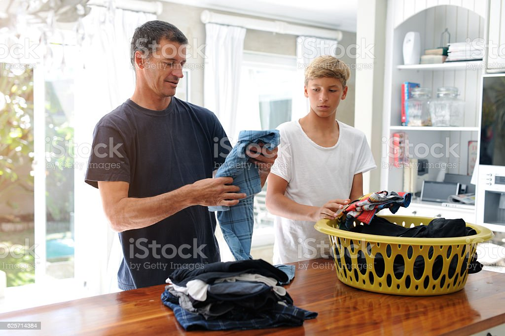 Tackling household chores together stock photo