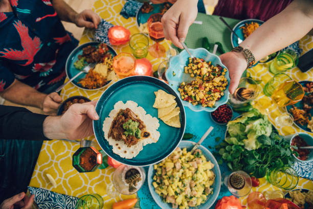 taco mexican tex med food lifestyles with friends eating dinner - mexican food stock photos and pictures