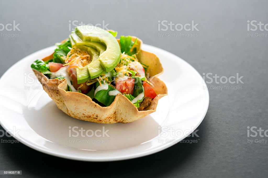 Taco salad in tortilla bowl stock photo