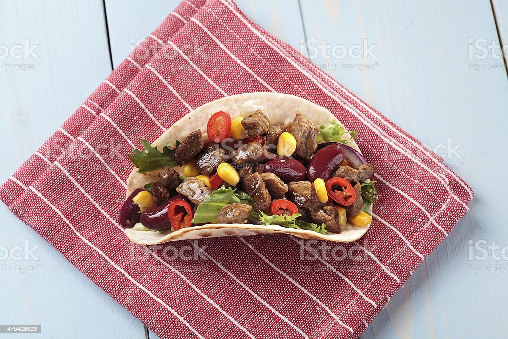 taco with beef and vegetables stock photo