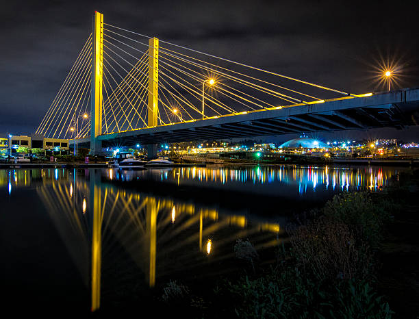 Tacoma Bridge Night time image of Bridge in Tacoma, WA over the Thea Foss waterway. tacoma stock pictures, royalty-free photos & images