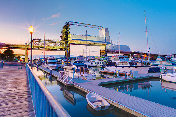 Tacoma downtown marina during twilight. WA Tacoma downtown marina with bridge and pier, Washington State. Murray Morgan Bridge tacoma stock pictures, royalty-free photos & images