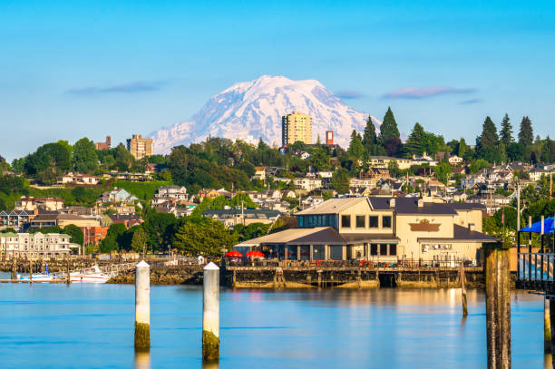 Tacoma, Washington, USA Tacoma, Washington, USA with Mt. Rainier in the distance on Commencement Bay. washington state stock pictures, royalty-free photos & images