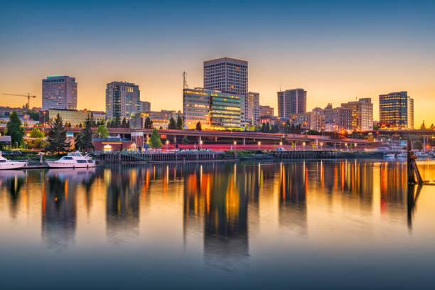 Tacoma, Washington, USA Skyline Tacoma, Washington, USA downtown skyline at dusk on Commencement Bay. pierce county washington state stock pictures, royalty-free photos & images