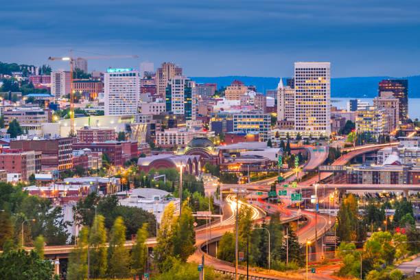 Tacoma, Washington, USA Skyline Tacoma, Washington, USA skyline at night. tacoma stock pictures, royalty-free photos & images