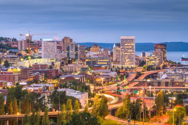 Tacoma, Washington, USA skyline Tacoma, Washington, USA skyline at night. washington state stock pictures, royalty-free photos & images