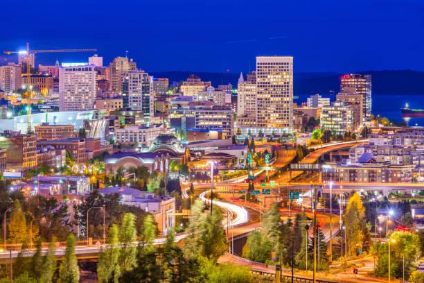 Tacoma, Washington, USA Skyline Tacoma, Washington, USA skyline at night. pierce county washington state stock pictures, royalty-free photos & images