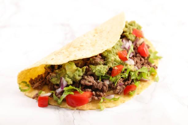 tacos, fajita on white background tacos, fajita on white background taco stock pictures, royalty-free photos & images