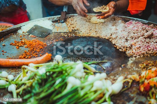 Close up of a Mexican hands making tacos at the street