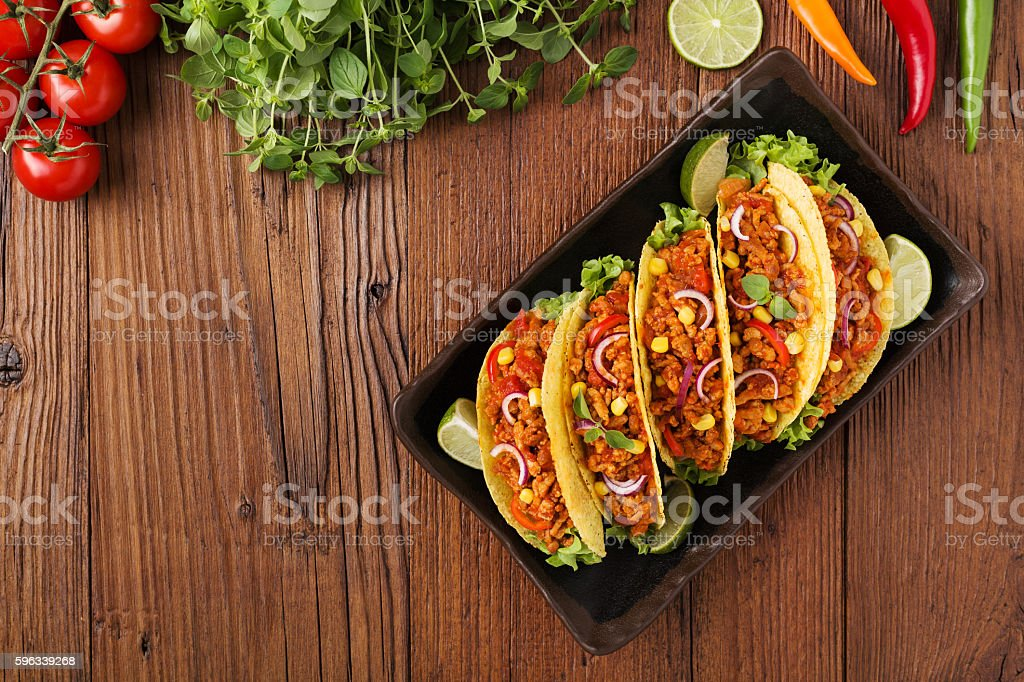 Tacos with meat and vegetables on wooden board stock photo