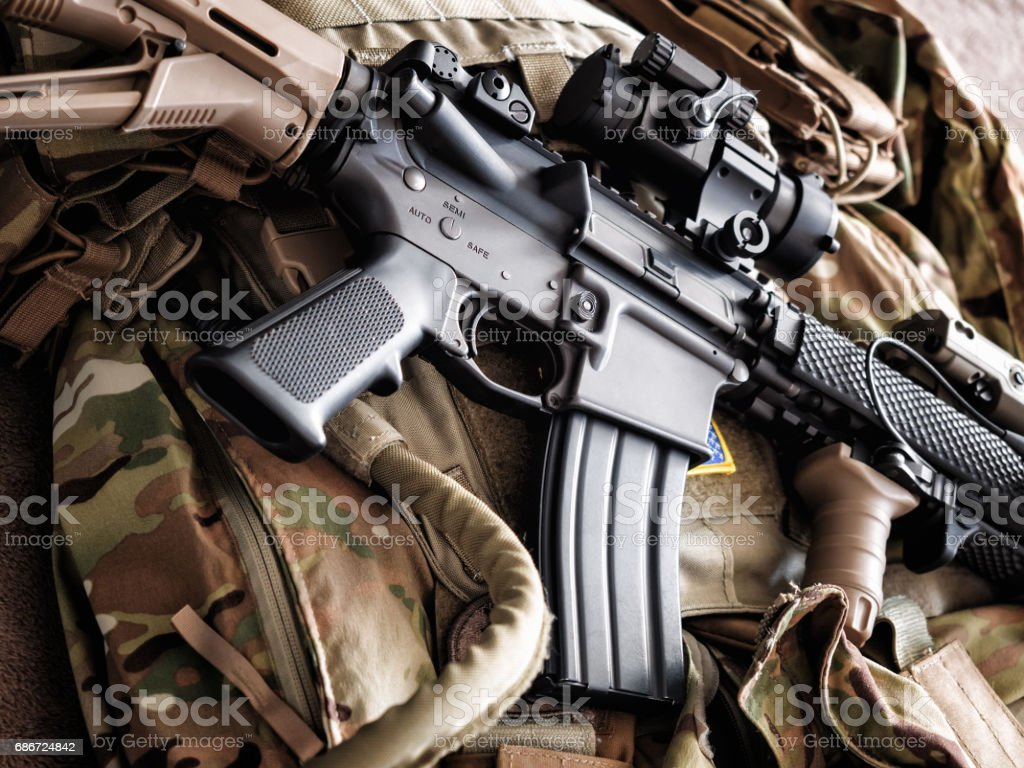 M4A1 (AR-15) tactical carbine on the bulletproof vest stock photo