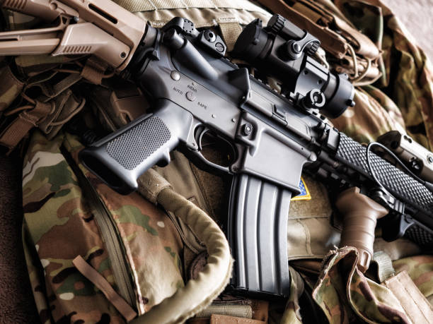 M4A1 (AR-15) tactical carbine on the bulletproof vest M4A1 (AR-15) tactical carbine on the bulletproof vest ar 15 stock pictures, royalty-free photos & images