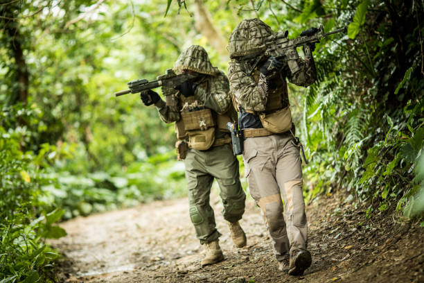 Tactical military airsoft soldiers in jungle stock photo