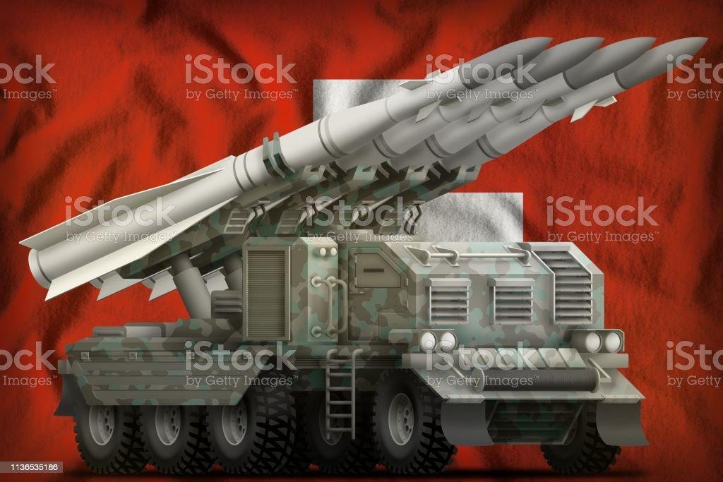 tactical short range ballistic missile with arctic camouflage on the Switzerland national flag background. 3d Illustration stock photo