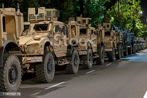 Warsaw, Poland - 12 August 2016: The military truck Oshkosh M-ATV 'MRAP' vehicles parked on the street at night before the parade on the Polish Armed Forces Day. The Oshkosh is an American tactical vehicles manufacturer. Presented truck is 2-axle, all-wheel-drive (4x4), high-mobility special vehicle.
