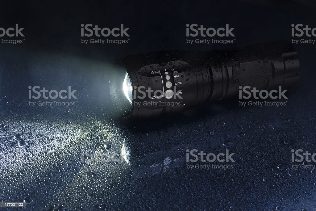 Tactical waterproof flashlight stock photo