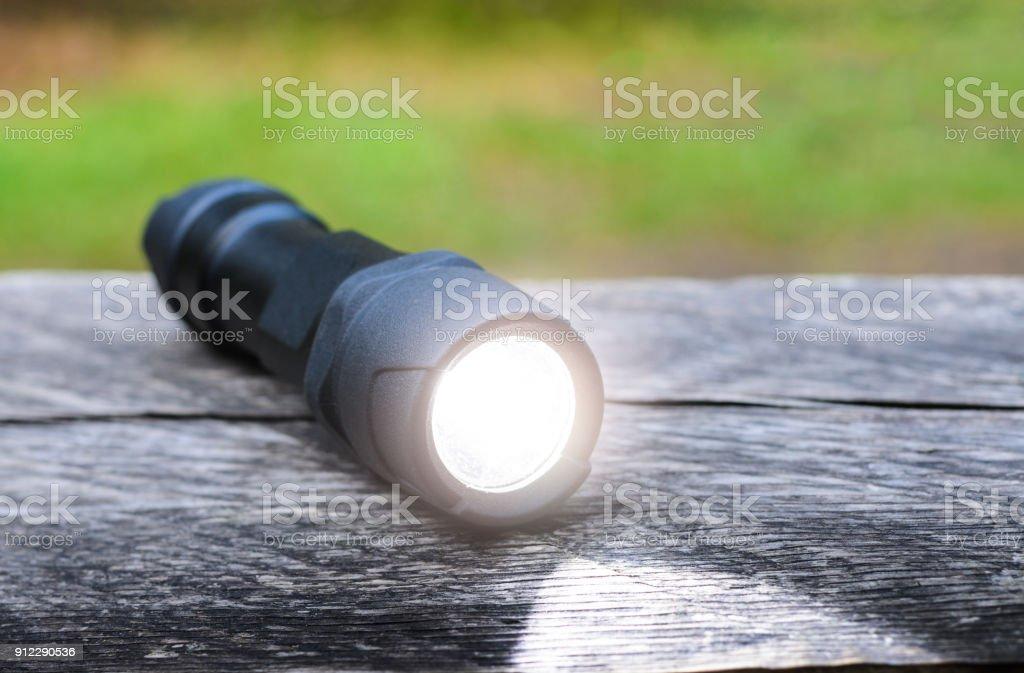 Tactical waterproof flashlight stock photo