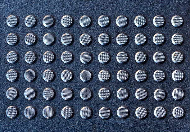 Tactile gray tiles on the sidewalk. Close up. stock photo