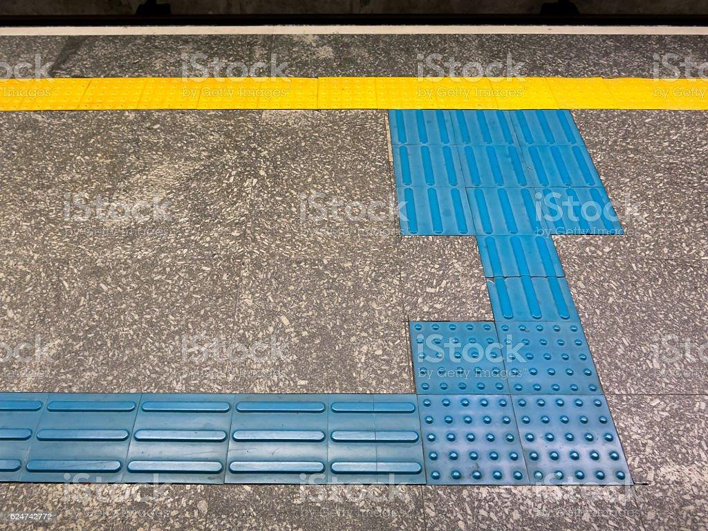 Tactile Ground Surface Indicators for visually impaired brazilian subway station stock photo