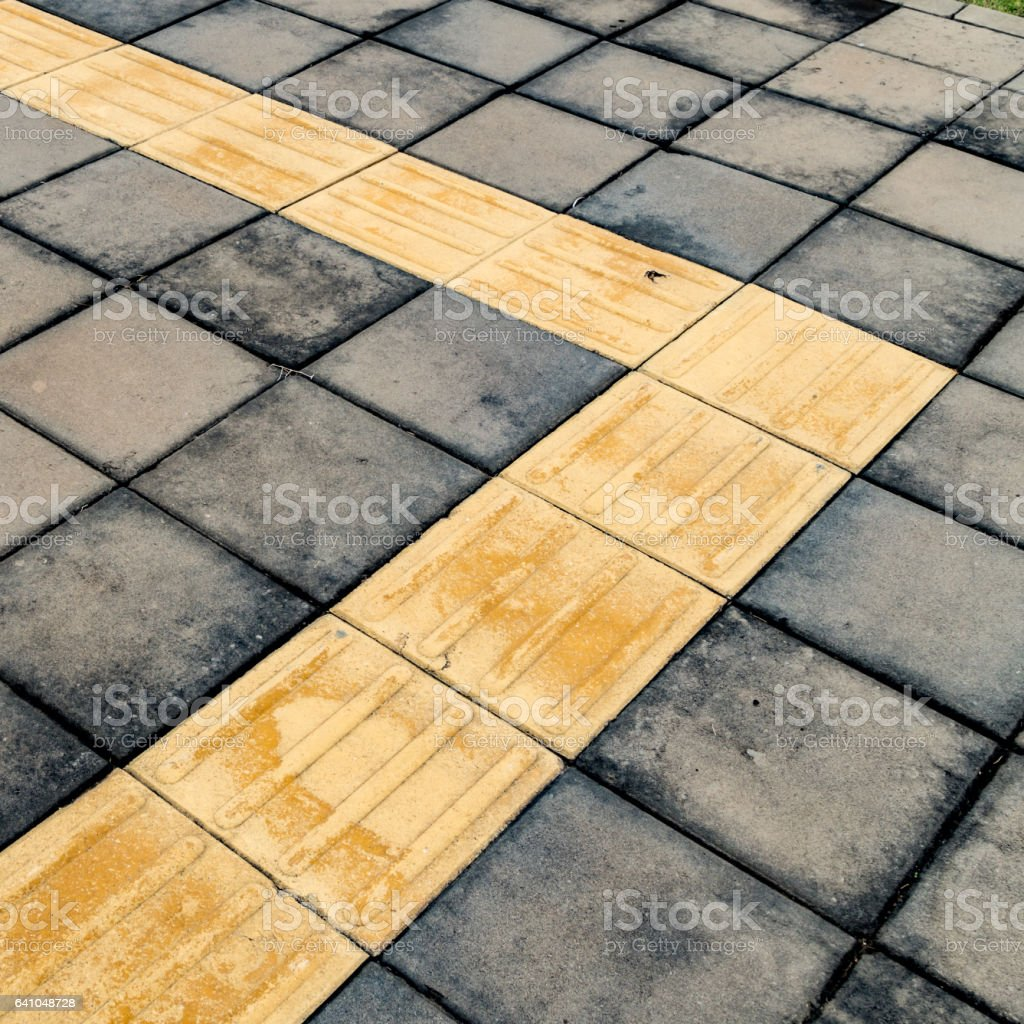 Tactile paving for blind handicap on concrete block pathway stock tactile paving for blind handicap on concrete block pathway royalty free stock photo dailygadgetfo Image collections