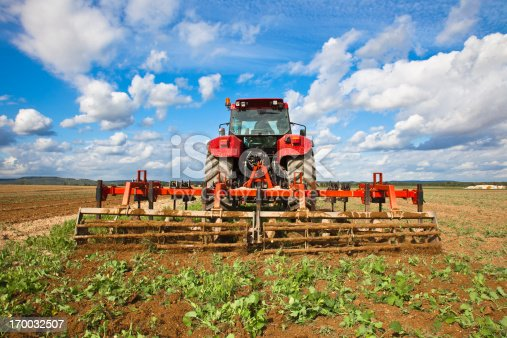 A tractor working on a cereal field